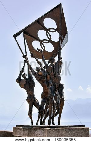 Monument Of People Carrying Olympic Flag At Olympic Park Lausanne
