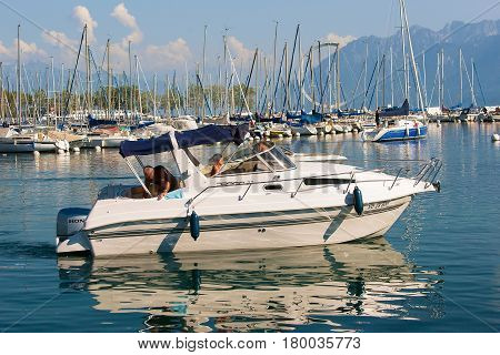 People In Yacht Sailing In Marina Of Lake Geneva Lausanne