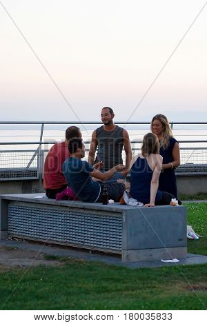 People Resting At Esplanade De Montbenon In Lausanne At Sunset
