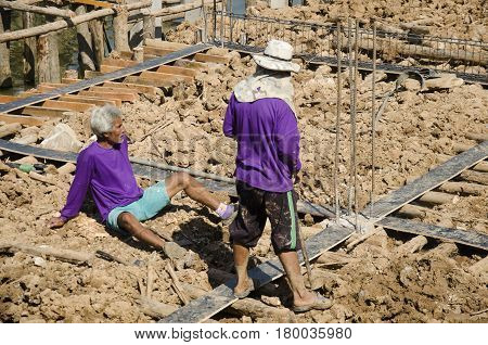 Asian thai workers and team working builder new building bridge at construction site of Bueng Boraphet public park on December 30 2016 in Nakhon sawan Thailand