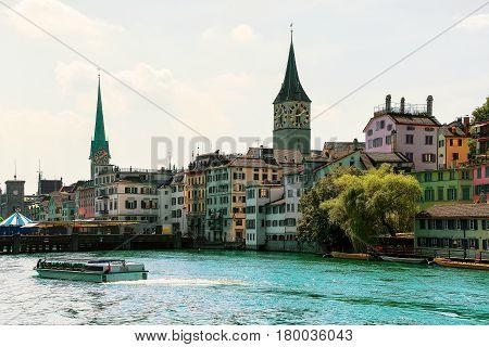 River Cruiser At Limmat Saint Peter And Fraumunster Zurich