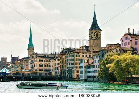 River Cruiser At Limmat Quay Saint Peter And Fraumunster Zurich