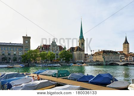 St Peter And Fraumunster Church And Boats At Limmat Zurich