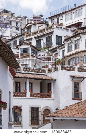 Staggered houses on steep hills in Taxco Mexico
