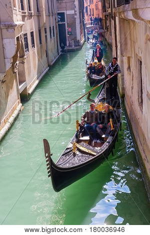 Typical Canal With Gondola In Venice, Italy