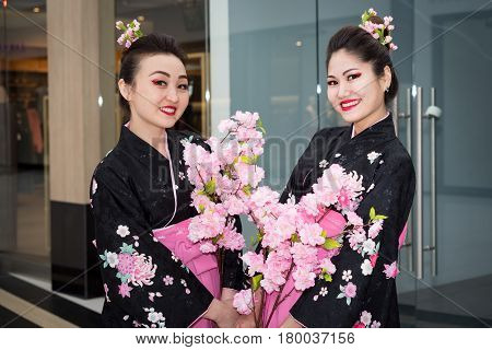 Moscow, Russia - April 02, 2017: Two Geisha In Traditional Japanese Kimono In The Shopping Center Ot