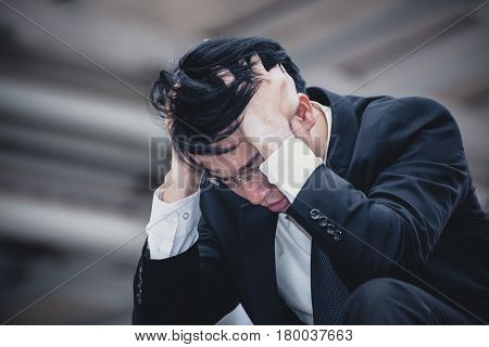 Asian Businessman Sad Worry Tired And Headache, Stress At Workplace, Feeling Ill, Finance Problem An