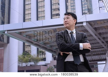 Confident Asian Businessman Standing And Looking At City For Vision Concept