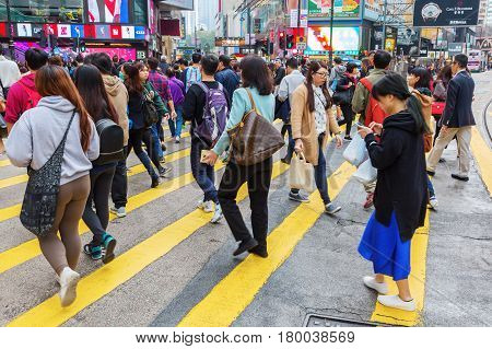 People Crossing Kings Road In Hong Kong