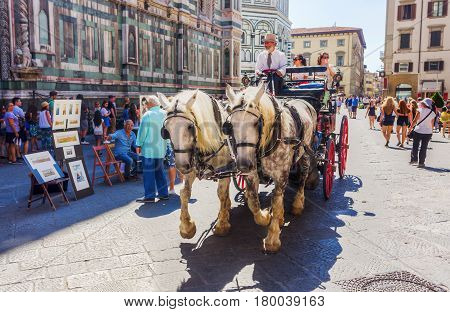 Horse Carriage And Street Painter In Florence, Italy