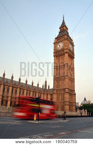 Big Ben The Houses of Parliament and a speeding London Double Decker Bus early on a Summer morning in London UK.