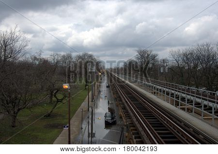 train tracks elevated above ground running parallel off to the horizon Chicago Transit