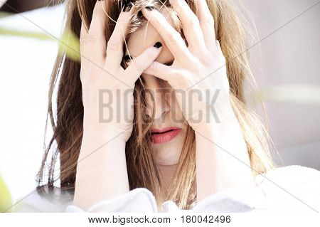 Depression. Depressed woman cover her face with her hands. Loneliness. Sadness. Sad woman.Depression concept.