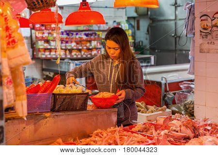 Young Woman At A Shop In Kowloon, Hong Kong