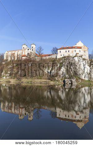 Benedictine abbey in Tyniec near Krakow reflection in the water Poland