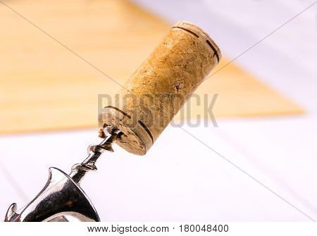 Wine cork and corkscrew close-up on table
