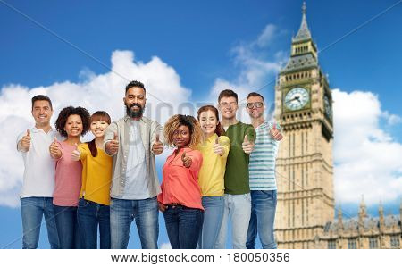 diversity, race, ethnicity and people concept - international group of happy smiling men and women showing thumbs up over london city and big ben tower background
