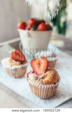 Cupcake with fresh strawberry powder with shugar