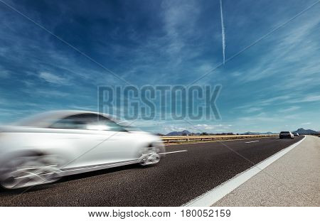 Highway speed auto trafic motion with sky background