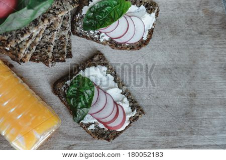 Fitness Bread With Cottage Cheese, Radish And Basil And Orange Juice On Rustic Wood Background, Clos