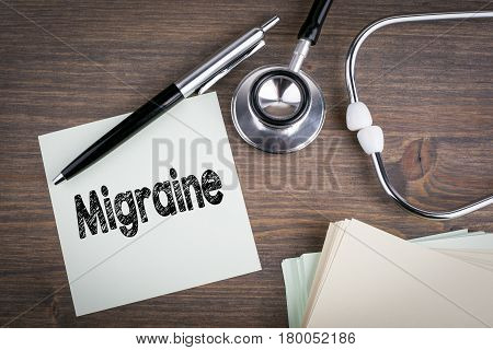 Migraine, Workplace of a doctor. Stethoscope on wooden desk background.