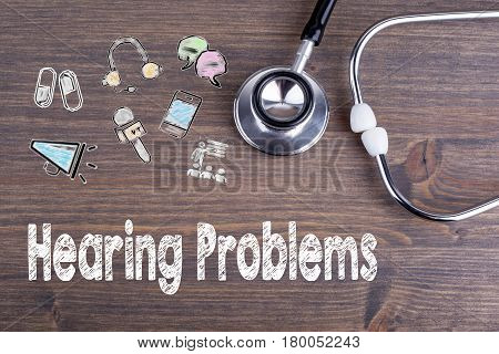 Hearing Problems. Workplace of a doctor. Stethoscope on wooden desk background.