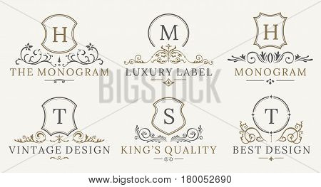 Retro Royal Vintage Shields Logotype set. Vector calligraphyc Luxury logo design elements. Business signs, logos, identity, spa, hotels, badges elements