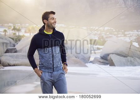 Handsome Smiling guy on beach looking away