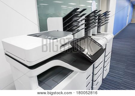close up office printers set up ready for printing business documents