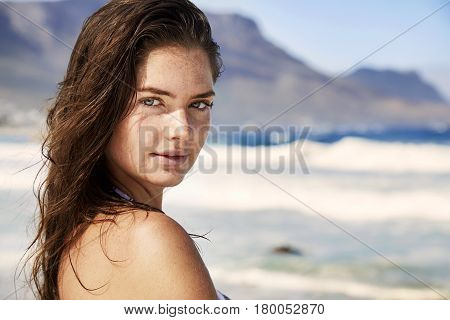 Young cute Brunette young woman on beach portrait