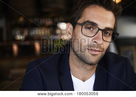 Stubble and glasses buy looking at camera