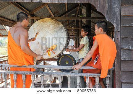 Buddhist Monk Playing Big Drum At Champasak On Laos