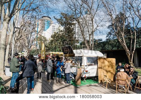 Madrid Spain - Januaty 22 2017: People eating and drinking in MadrEat a street fod event in Azca downtown district.