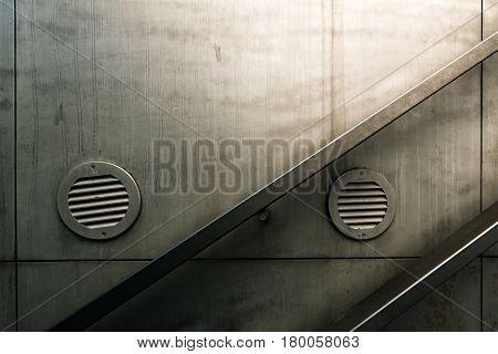 Urban staircase handrail detail from street underground passage way