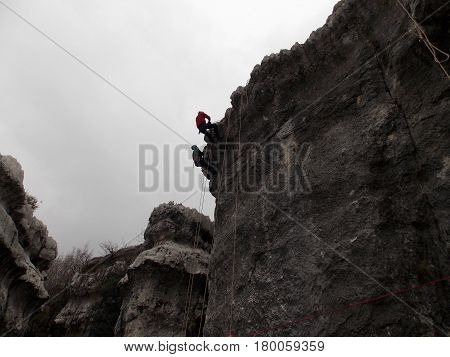 two climber rappelling on the top of a cliff in Lebanon