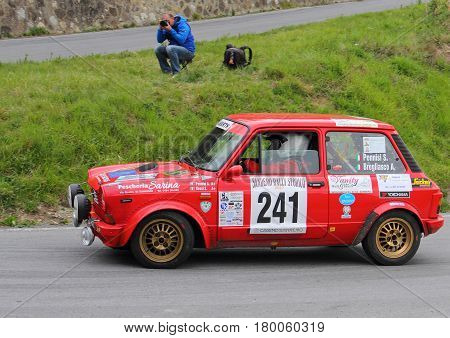 Testico Italy - April 01 2017-64 Di Sanremo Rally: The A 112 Abarth conducted by the crew Pennisi-Bregliasco during the second special stage of speed 'timed race, one that led to the summit from Testico' del Colle D'Oggia.