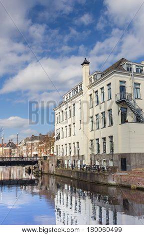 GRONINGEN, NETHERLANDS - APRIL 03, 2017: Old building at a canal in Groningen, The Netherlands