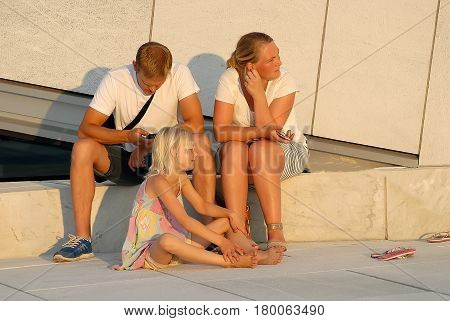 Oslo Norway - July 22 2014: People wait performance near Oslo Opera House in sunny summer day