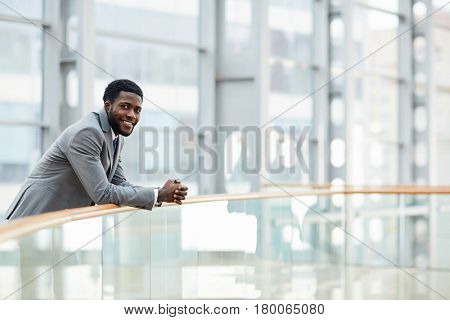 Self-employed professional in sphere of management looking at camera