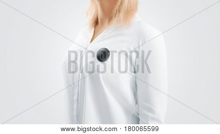 Blank black button badge mockup pinned on the womans chest, side view. Girl wear white shirt and campaign pin mock up. Volunteer round emblem design element. Pesron stand with canvass voting symbol