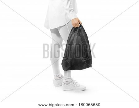 Blank black t-shirt plastic bag mockup holding hand. Woman hold space carrier sac mock up. Disposable bagful branding template. Shopping carry package in persons arm. Promotional packet for branding.
