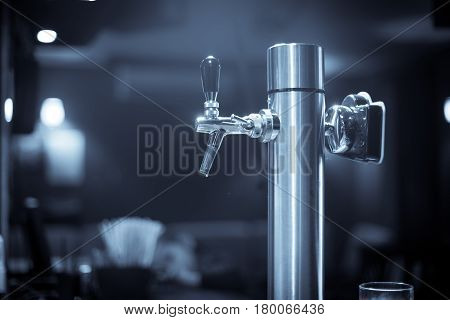 Color close up image of a beer tap in bar or restaurant.