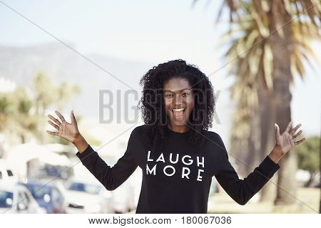 Young Beautiful woman with slogan outdoor portrait