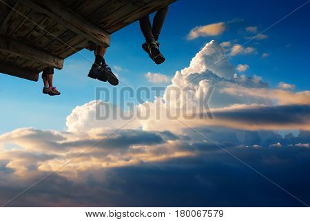 People Sit High Above The Ground