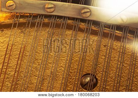 The internal components of the old piano strings and soundboard