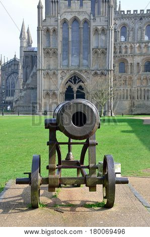 Canon at front of Ely Cathedral cambridgeshire east anglia