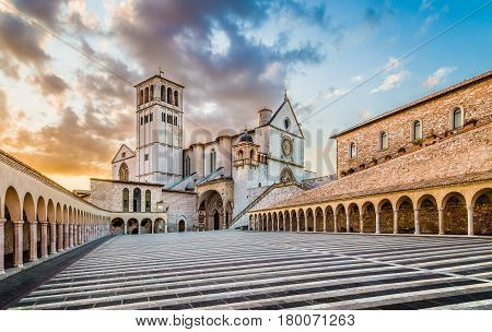 Famous Basilica Of St. Francis Of Assisi (basilica Papale Di San Francesco) With Lower Plaza At Suns