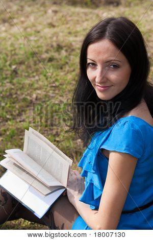 Girl Reading Book In Spring Park