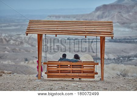 Mitzpe Ramon, 01 December 2016: Couple On Swings At Mitzpe Ramon