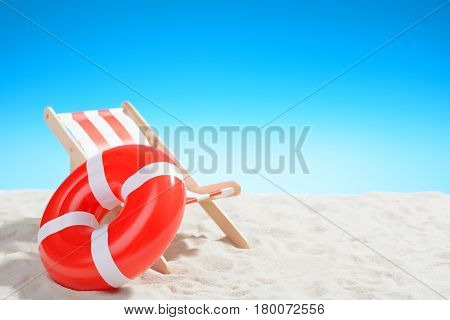 Deckchair And Swimming Ring On The Beach